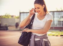 After workout call your friends for coffee. Young woman. Royalty Free Stock Photo