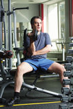Workout with dumb-bell. Man in shirt and shorts at gym have workout with dumb-bell Royalty Free Stock Image