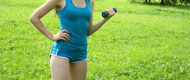 Workout with dumbbell Stock Images