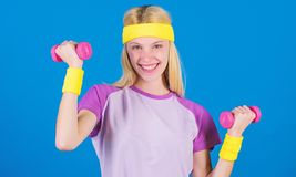 Workout with dumbbell. Beginner dumbbell exercises. Ultimate upper body workout for women. Fitness instructor hold. Little dumbbell blue background. Fitness royalty free stock image