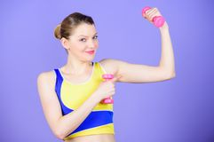 Workout with dumbbells. Girl hold dumbbells. Biceps exercises for female. Sport is the way of her life. Healthy stock image
