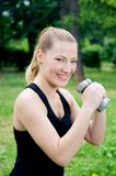 Workout with dumbbells Stock Images