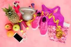 Workout equipment objects on pink floor Stock Photo