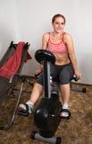 Workout on Exercise Bike Royalty Free Stock Image