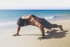 Workout exercise concept. Healthy Handsome Active Man With Fit Muscular Body Doing Push Ups Exercises. Sporty Athletic stock image