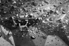 Workout exercise. Sporty male training indoor, climbing a boulde. Ring wall. Healthy lifestyle concept Stock Image