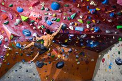 Workout exercise. Sporty male training indoor, climbing gym. Sports and fitness concept Stock Photography