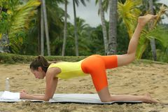 Workout exercises on the beach Stock Photos
