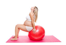Workout with fitness ball during pregnancy Royalty Free Stock Image