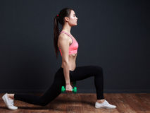 Workout and fitness - slim athletic woman doing squats with a we Royalty Free Stock Photography
