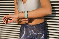 Workout goals concept. Timing workout goals concept. Woman using sporty smart watch for checking training stock photo