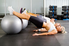 Workout in gym. Group of young people workout in gym with fitness balls Royalty Free Stock Photo