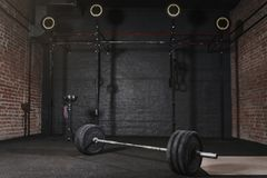 0Workout gym with cross fit equipment. Barbell horizontal bars gymnastic rings stock image