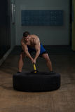 Workout At Gym With Hammer And Tractor Tire Stock Images