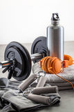 Workout, gym lifestyle and equipment concept for male sports. Workout, gym lifestyle and equipment concept - still-life of dumbbells, hand grip with orange Stock Photos