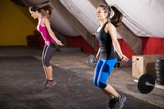 Workout with a jump rope. Pretty athletic girls using jump ropes for her workout in a gym Stock Photos