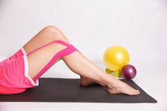 Workout after leg injury with kinesio tape Stock Photos