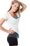 Workout look. Young woman poses wearing her workout outfit Stock Photo