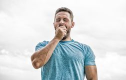 After workout. man athlete in blue sport tshirt. sportswear fashion. yawning muscular male with beard. sleepy man stock photography