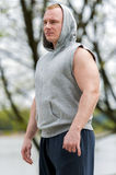 Workout man in hood resting. Outdoor. Royalty Free Stock Image