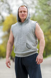 Workout man in hood resting. Outdoor. Royalty Free Stock Photos
