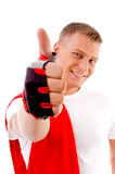 Workout - man with thumbs up at gym stock image
