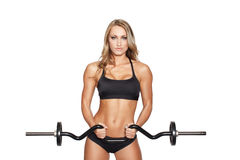 Workout with olympic curl bar isolated. Sexy blonde fitness model workout with olympic curl bar, isolated on white Royalty Free Stock Image