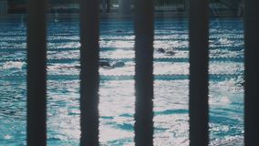 Workout in opened swimpool stock video footage