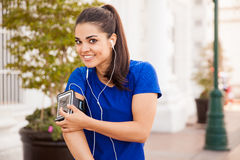 Workout out with some music. Portrait of a pretty Latin brunette wearing his phone in an armband and ready to workout with some music Royalty Free Stock Image