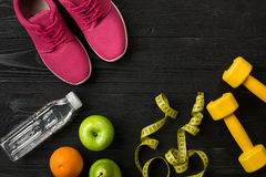 Workout plan with fitness food and equipment on dark background, top view stock photography