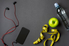 Workout plan with fitness food and equipment on gray background, top view. Workout plan with fitness food and sport equipment on gray background, top view. Copy stock images