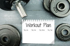 Workout plan with weight plates Royalty Free Stock Photography