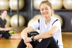 Workout portrait of a smiling woman at fitness center Royalty Free Stock Photography