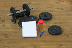 After a workout, recording the results and analyzes on the table Royalty Free Stock Images