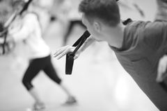 Workout with resistance band, monochrome Stock Photos