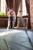 Workout with ropes at home. Stock Photo