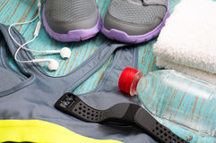 Workout set with sport clothing and heart rate monitor Royalty Free Stock Photography