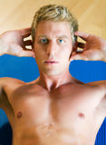 Workout - situps. Strong, handsome man doing sit-ups stock images