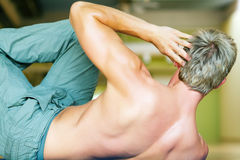 Workout - situps. Strong, handsome man doing sit-ups royalty free stock photos