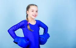 Workout of small girl boxer. Fitness diet. energy health. punching knockout. Childhood activity. Sport success. Sportswear fashion. Happy child sportsman in royalty free stock photography