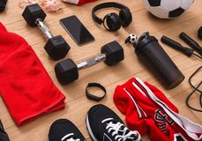 Workout, soccer and sport equipment background. Set of fitness male outfit. Active lifestyle, body care concept Stock Image