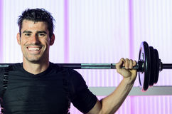 Workout Training. Man smiling and lifting weight training in gym Stock Photo