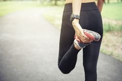 Workout wellness concept. Close up runner feet with running shoe royalty free stock photography