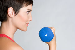Workout Woman. Fitness workout woman lifting weights Royalty Free Stock Photo