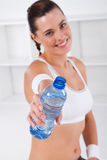 Workout woman. A pretty workout woman drinking a bottle of refreshing water after exercising Royalty Free Stock Photo