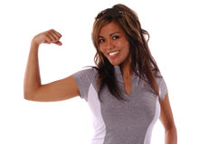 Workout Woman. Sexy workout woman flexes her muscels Stock Image