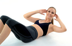 Workout woman. Woman on fitness clothes doing exercises for her abdominals Stock Images