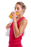 Workout woman drinking juice Royalty Free Stock Images