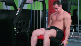 Workout for young bodybuilder stock video footage