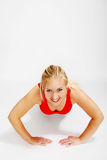 The workout of young woman Stock Photography